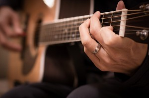 Playing Guitar Christian Stock Photo